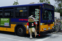 Mascot Standing Outside Bus Door